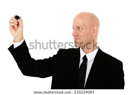 Middle aged bald businessman using marker - stock photo
