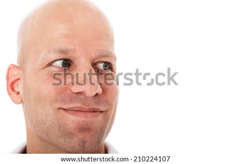 Middle aged bald man looking to the side - stock photo