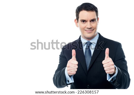 Middle aged business man showing thumbs up gesture  - stock photo