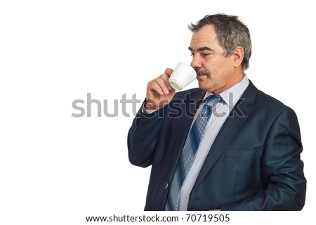 Middle aged business man standing in semi profile and drinking a cup of coffee in a business break,copy space for text message in left part of image isolated on white background - stock photo