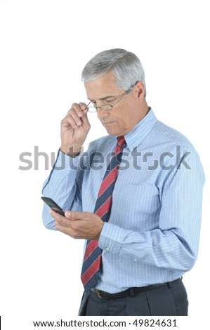 Middle Aged Businessman Looking at Cell Phone while adjusting his eye glasses isolated over white - stock photo