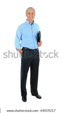 Middle aged businessman with one hand in pocket and a notebook under the other arm. Man is smiling and standing. Full length shot isolated over white - stock photo