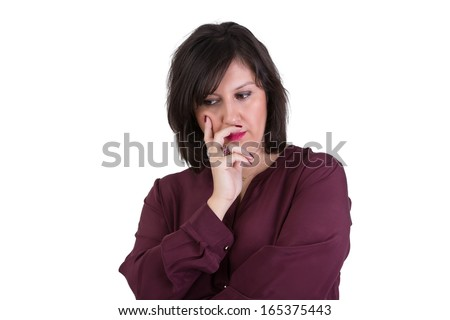 Middle Aged Businesswoman in shirt looking down thoughtfully with her hand on her face - stock photo