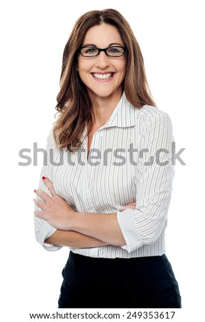 Middle aged businesswoman with folded arms - stock photo