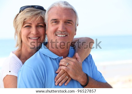 Middle-aged couple at the coast - stock photo