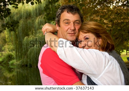 Middle Aged couple in love in the woods - stock photo