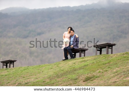 middle aged couple in natural - stock photo