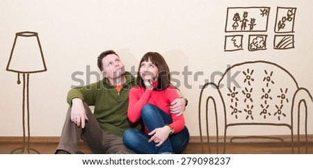 Middle aged couple in the new flat. Embracing man and woman at new empty apartment. - stock photo