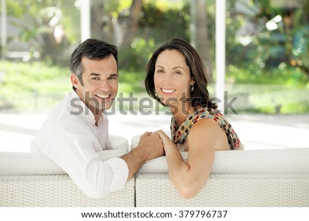 Middle-aged couple intimacy - stock photo