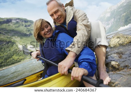 Middle-aged Couple on a Kayaking Trip - stock photo
