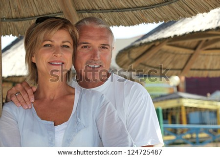 Middle-aged couple on holiday - stock photo