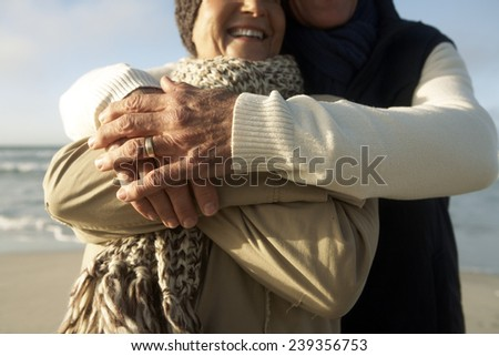 Middle-Aged Couple on the Beach - stock photo