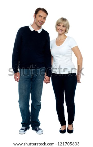 Middle aged couple posing with hand in hand, strong bonding and love. - stock photo