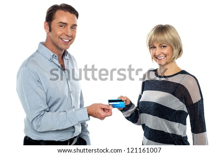 Middle aged couple showing a cash card to the camera. Half length portrait. - stock photo