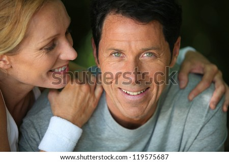 Middle-aged couple smiling - stock photo