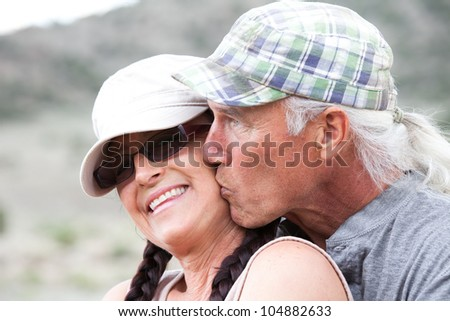 Middle Aged Happy Romantic Couple outside in the summer - stock photo