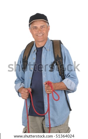 Middle aged hiker wearing a backpack and holding a rope. 3/4 view of man shot in vertical format isolated over white. - stock photo