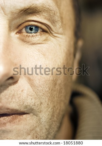 Middle-aged man face fragment - stock photo