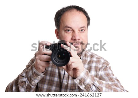 middle aged man holding dslr camera and smiling - stock photo