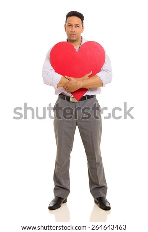 middle aged man hugging red heart shape isolated on white background - stock photo