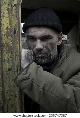Middle-aged man in a difficult situation on the street - stock photo