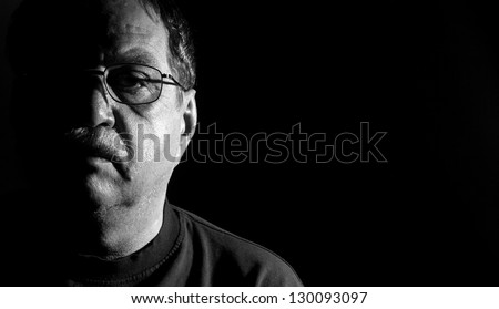 middle-aged man in eyeglasses, black and white - stock photo