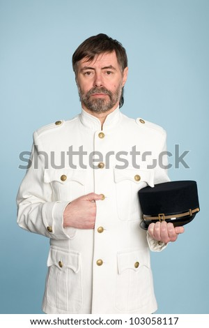 Middle aged man in the form of a naval officer with a cap - stock photo