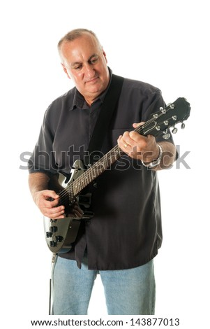 Middle-aged man playing black electric guitar. Shot on white background. - stock photo