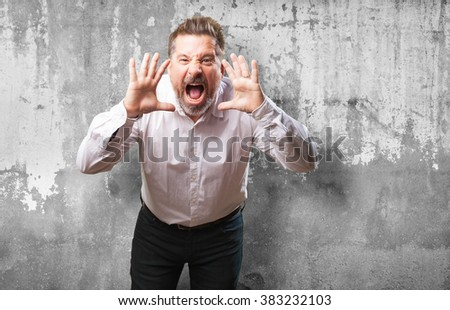 middle aged man shouting - stock photo