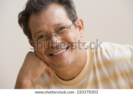 Middle aged man smiling for the camera - stock photo