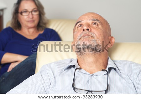 Middle aged man talking to psychologist - stock photo