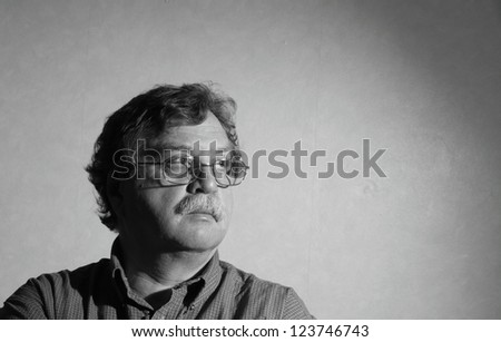 middle aged man with glasses and a plaid shirt - stock photo