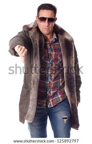 middle aged man with winter clothing makes negative gesture - stock photo
