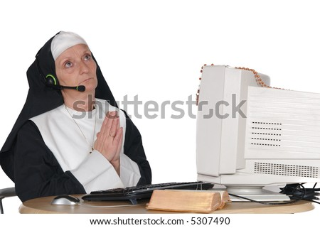 Middle aged nun, sister on computer, connection with god.  Religion, christianity, lifestyle,  communication concept - stock photo