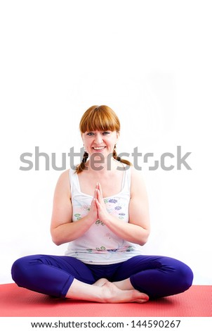 middle aged redhead woman exercising yoga isolated on white - stock photo