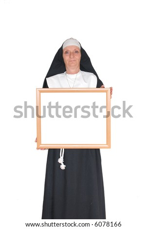 Middle aged smiling nun with advertising board - stock photo