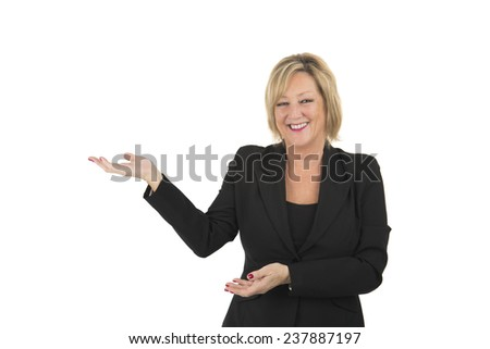 Middle aged woman doing a presenting gesture against a white background - stock photo