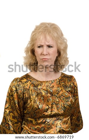 Middle-aged woman frowning over something creating a furrowed brow - stock photo