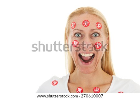 Middle aged woman happy with reduced prices - stock photo