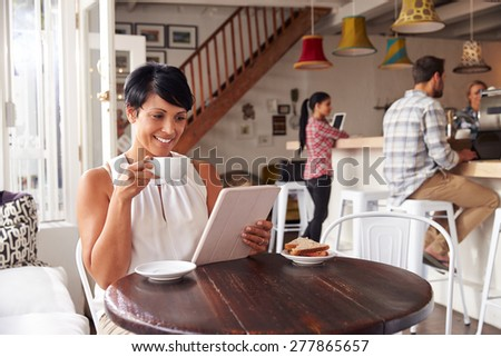 Middle aged woman in a cafe - stock photo