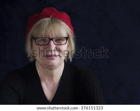 middle aged woman in eyeglasses - stock photo
