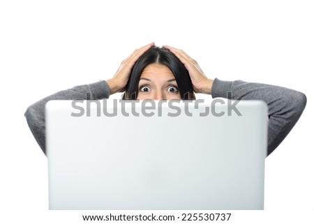 Middle Aged Woman in Surprise Facial Expression with Both Hands on the Head Facing a Computer. Isolated on White Background. - stock photo