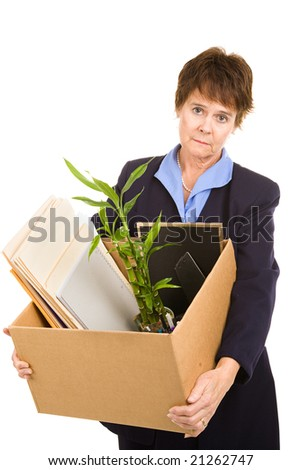 Middle aged woman laid off from her white collar job carries a box of her belongings.  Isolated on white. - stock photo