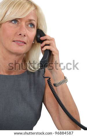 Middle-aged woman on the phone - stock photo