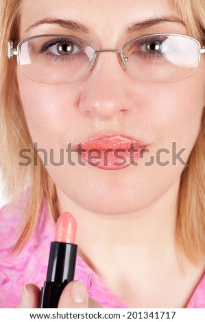 middle aged woman painting her lips - stock photo