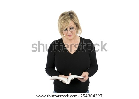 Middle aged woman reading a book against a white background - stock photo