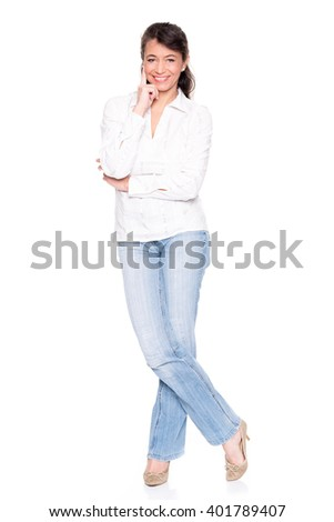 Middle aged woman standing in front of white background  - stock photo