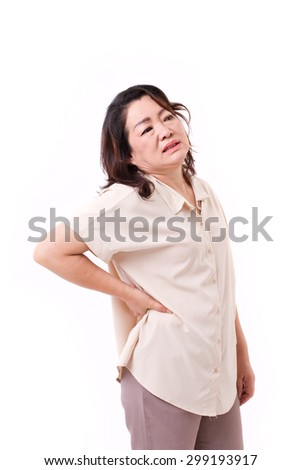 middle aged woman suffering from neck pain - stock photo