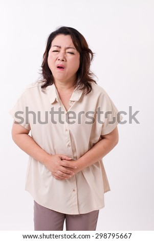 middle aged woman suffering from stomach ache, belly pain, menstuation, menopause, indigestion problem - stock photo