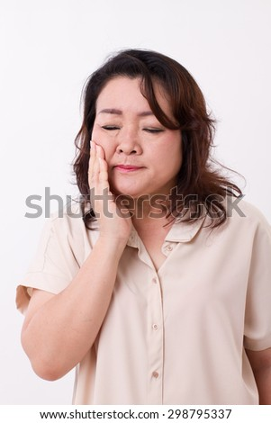 middle aged woman suffering from toothache - stock photo